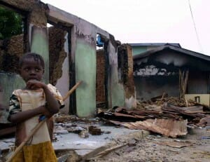 HRW A displaced child in front of her home, which was destroyed in regional conflict