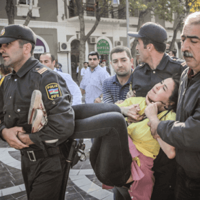 Photo from Art for Democracy photo exhibition by Aziz Karimov. Fountain Square, Baku, 20 October 2012. It shows police detaining an opposition activist during an unsanctioned protest calling for parliament to be dissolved..