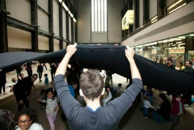 "What's underneath Tate's redactions? Liberate Tate's ""Hidden Figures"" performance at Tate Modern. Photo: Martin LeSanto-Smith"