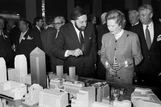 Margaret Thatcher is shown a model of  Canary Wharf by Paul Reichmann, head of the Wharf's developers, Olympia & York