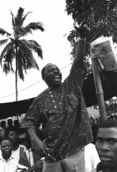 Ken Saro-Wiwa, local leader, speaking at Ogoni Day demonstration, Nigeria, 1993. The demonstration was officially called to mark the start of UNICEF's International Year of Indigenous People, but unofficially it was against the Shell oil company. Shell operates many oilfields in the Bori region and there have been many blowouts and leaks.