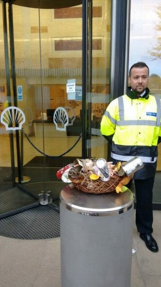 Security guard at the doors of the Shell Centre and the wreath for the Ogoni 9