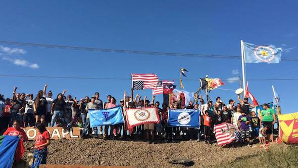 Protestors against the DAPL on the banks of the Cannonball River