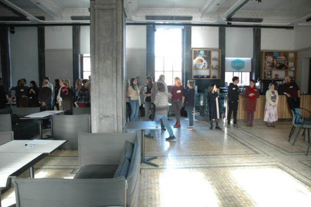 Attendees of Art-Possibility-Change gathered in the main hall of the former Central Post Office, Sheffield