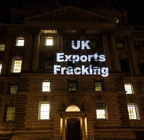 PHOTOS: 'Fracking rig' & 10-metre projection protests fossil fuel finance on doorstep of UK government export body